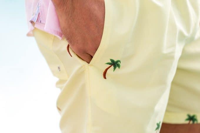 Palm Yellow Swim Shorts hand in pocket