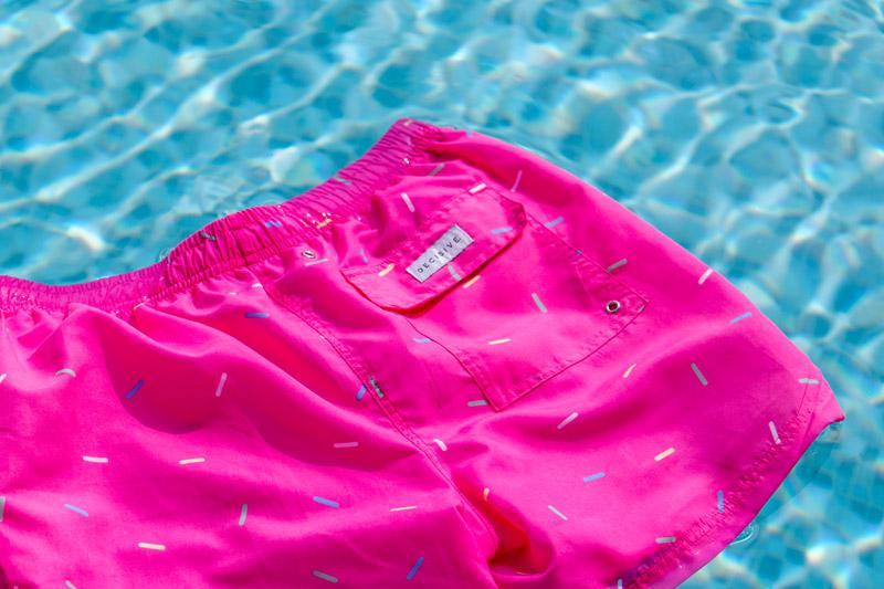 Sprinkles swim shorts in pool